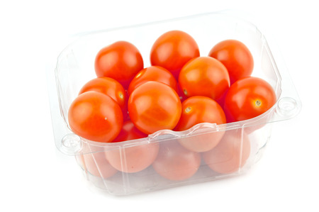 cherry Tomatoes In Plastic Retail Supermarket Packaging isolated on white background  photo
