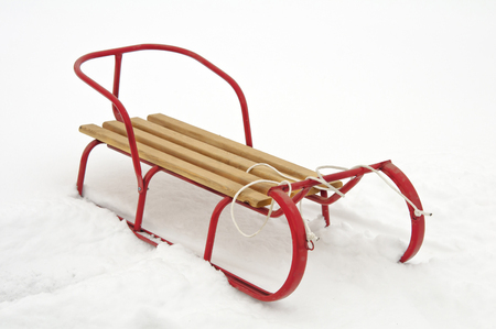 red sledge in the snow Stock Photo - 25474970
