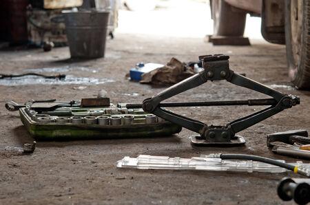 lug: auto parts that include a car jack, lug wrench Stock Photo