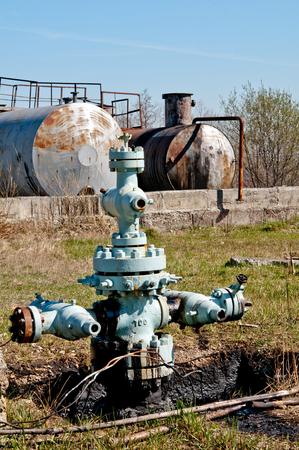 preasure: old rusty oil rigs with preasure valve  Stock Photo
