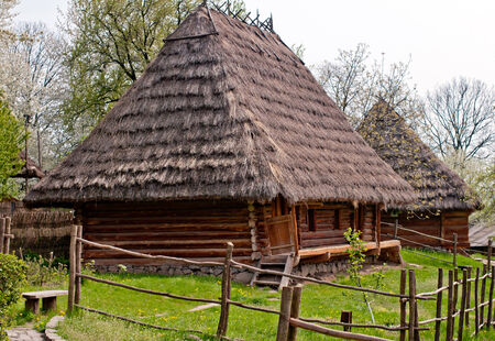 lopsided: old wooden house. Museum of Folk Architecture in Uzhhorod  Stock Photo