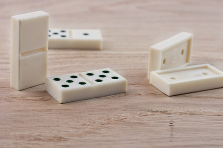 top seven: top view of dominoes playing on wooden table  Stock Photo