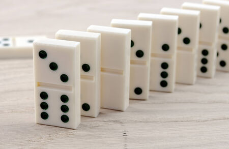 top seven: top view of domino playing on wooden table