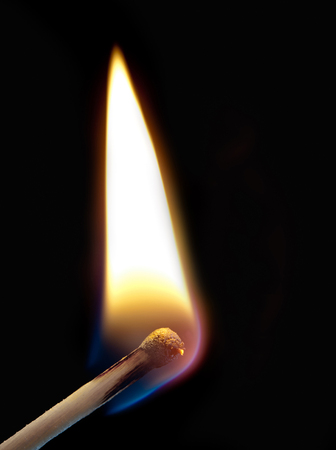 ignition: ignition of a match, with smoke on dark background