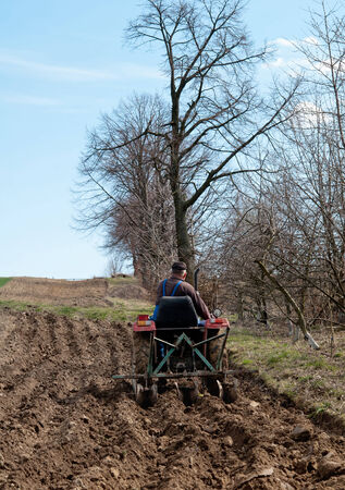 industrialized country: tractor plowing the fields in spring Stock Photo