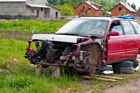 undisturbed: old car sit undisturbed in a field