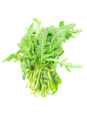 roquette: green rocket or roquette leaves isolated on white