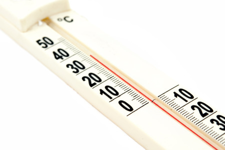 calibrated: Close up of a thermometer on white background
