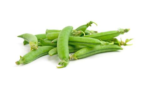 snap: freshly green sugar snap peas on white background