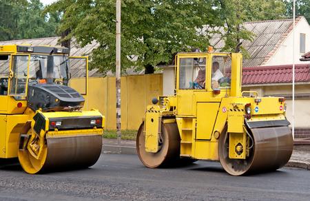 compactor: road repair, compactor lays asphalt Stock Photo