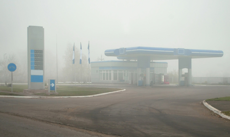 petrol station: petrol station in fog. Close up