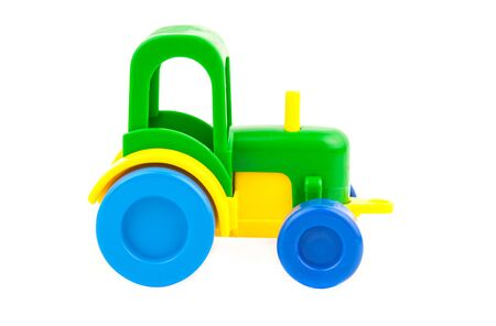 wheel tractor: toy tractor isolated on white background