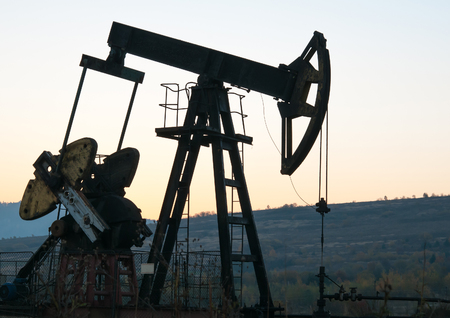 remediation: operating oil profiled on sunset sky Stock Photo
