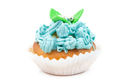 butter icing: Teal birthday cupcake with butter cream icing isolated on white
