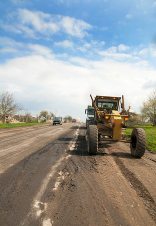 grader: grader is working on road construction
