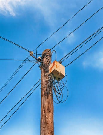 messy: messy wire on electricity post Stock Photo