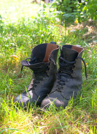 hillwalking: dirty hiking (military) boots in the photo
