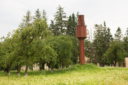rusts: an old water tower on a farm