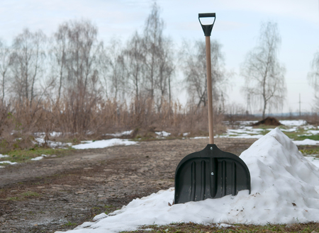 shovel in snow on nature Stock Photo
