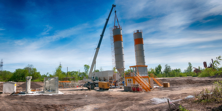 installation of concrete unit against the sky Stock Photo