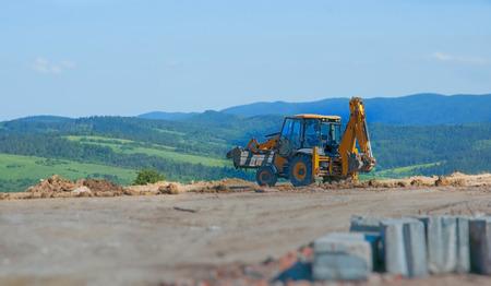 yellow bulldozer a moving land shovel