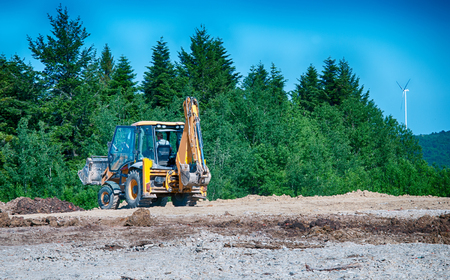 yellow bulldozer a moving land shovel photo