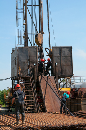 oil field, the oil workers are working photo