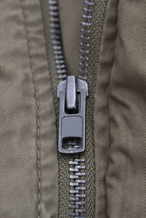 metal fastener: gray fabric and lock. Close up Stock Photo