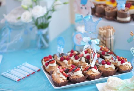 dessert table for a party. Cupcakes, sweetness and flowers