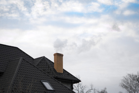 Close up chimney on the roof Imagens