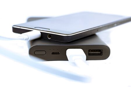 The smartphone is charged from the portable power banks