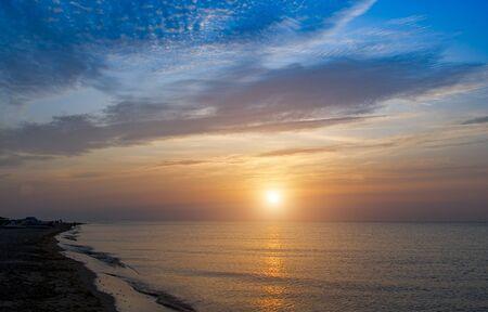 sunrise over the sea and beautiful cloudscape. Stock Photo