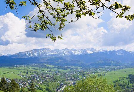 Inspiring Mountains Landscape Panorama, beautiful day in summer Tatras, mountain ridge over blue sky in Zakopane, Poland Stock Photo