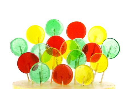 Assorted colors lollipops isolated on white background, close-up. This image is isolated with light during the photo shoot process.