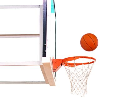 Basket ball inside the net isolated on white background Standard-Bild