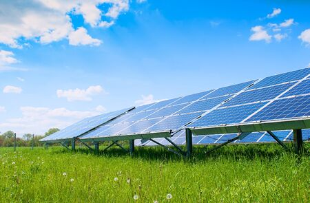 Solar panels and blue sky. Solar panels system power generators from sun. Clean technology for better future Stock Photo