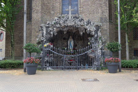 bible flower: Holy Mary statue in chapel with the appearance of a grotto.