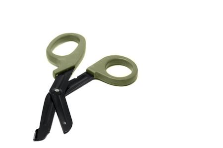 Medical bandage khaki scissors isolated on white background. trauma sheers.