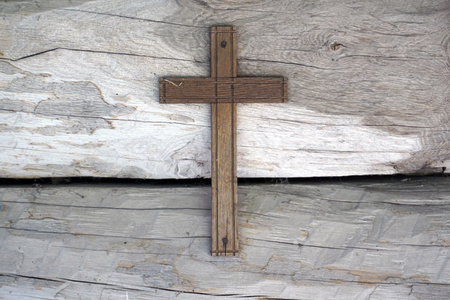 wooden Cross on wooden background wall Stock Photo