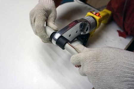 Plumber welded plastic pipes;