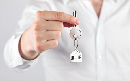 giving house key with a keychain house form Stock Photo - 12696955
