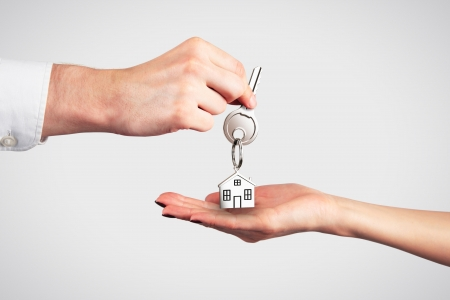 hand move: Handing Over the Key from a New Home Stock Photo
