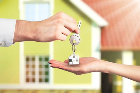 real estate house: Handing Over the Key from a New Home Stock Photo