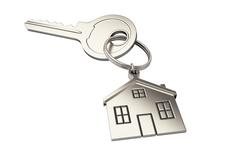 sell house: House shaped keychain isolated on white background