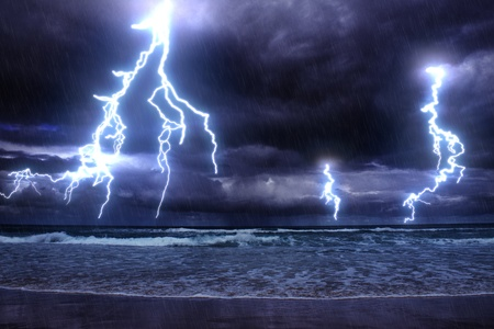 storm on the sea with lightnings photo
