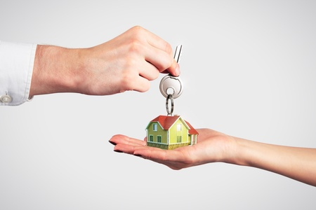 Handing Over the Key from a New Home Stock Photo - 13552899