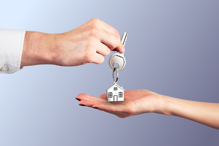 Handing Over the Key from a New Home Stock Photo - 13552898