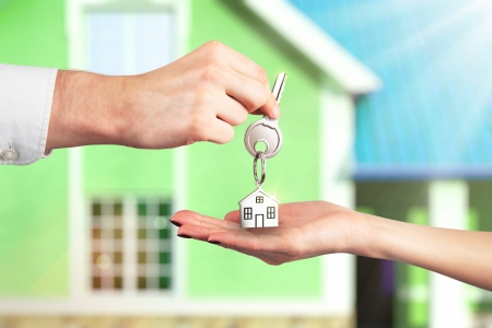 suburban home: Handing Over the Key from a New Home Stock Photo
