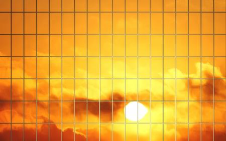 sun reflection in glass wall of skyscraper Stock Photo