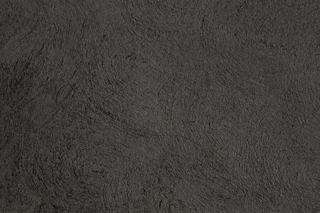 black concrete wall background closeup photo
